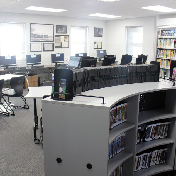 The main area at Bragtown, with DVD and book shelving, computers, and large tables