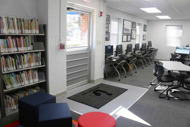 Bragtown's main entrance with new widened doorway, children's books to the left. and computer area to the right