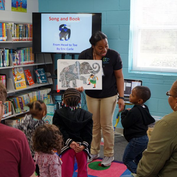 """An active storytime, with children enacting the motions from Eric Carle's """"From Head to Toe"""""""
