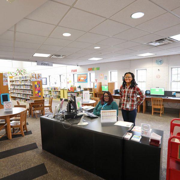 Library staff at the children's area info desk
