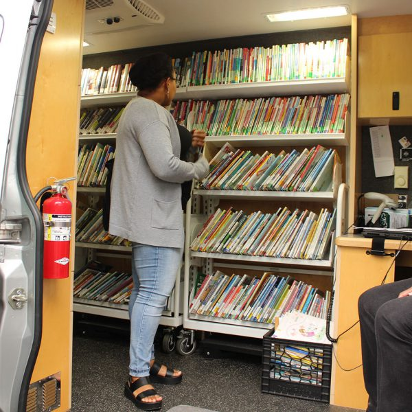 Browsing the shelves inside the Bookmobile