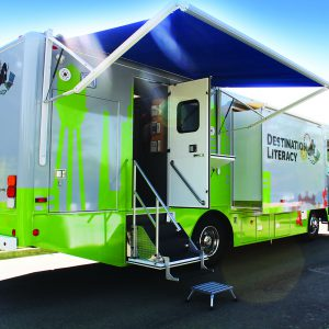 The Tech Mobile: a large vehicle with open doors and extended canopies
