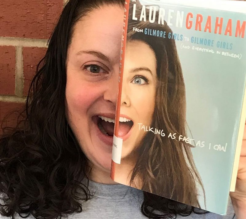 """Monica holding up the cover of """"Talking as Fast as I Can"""" by Lauren Graham to create her #bookface"""