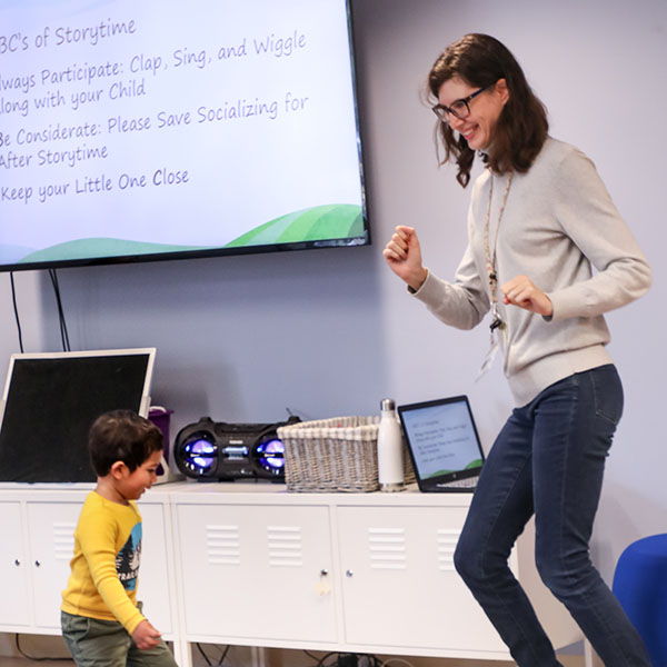 Ms. Teresa dancing with the kids during Toddler Storytime