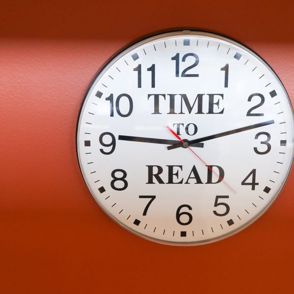 """Clock with the words """"Time to read"""" on its face"""