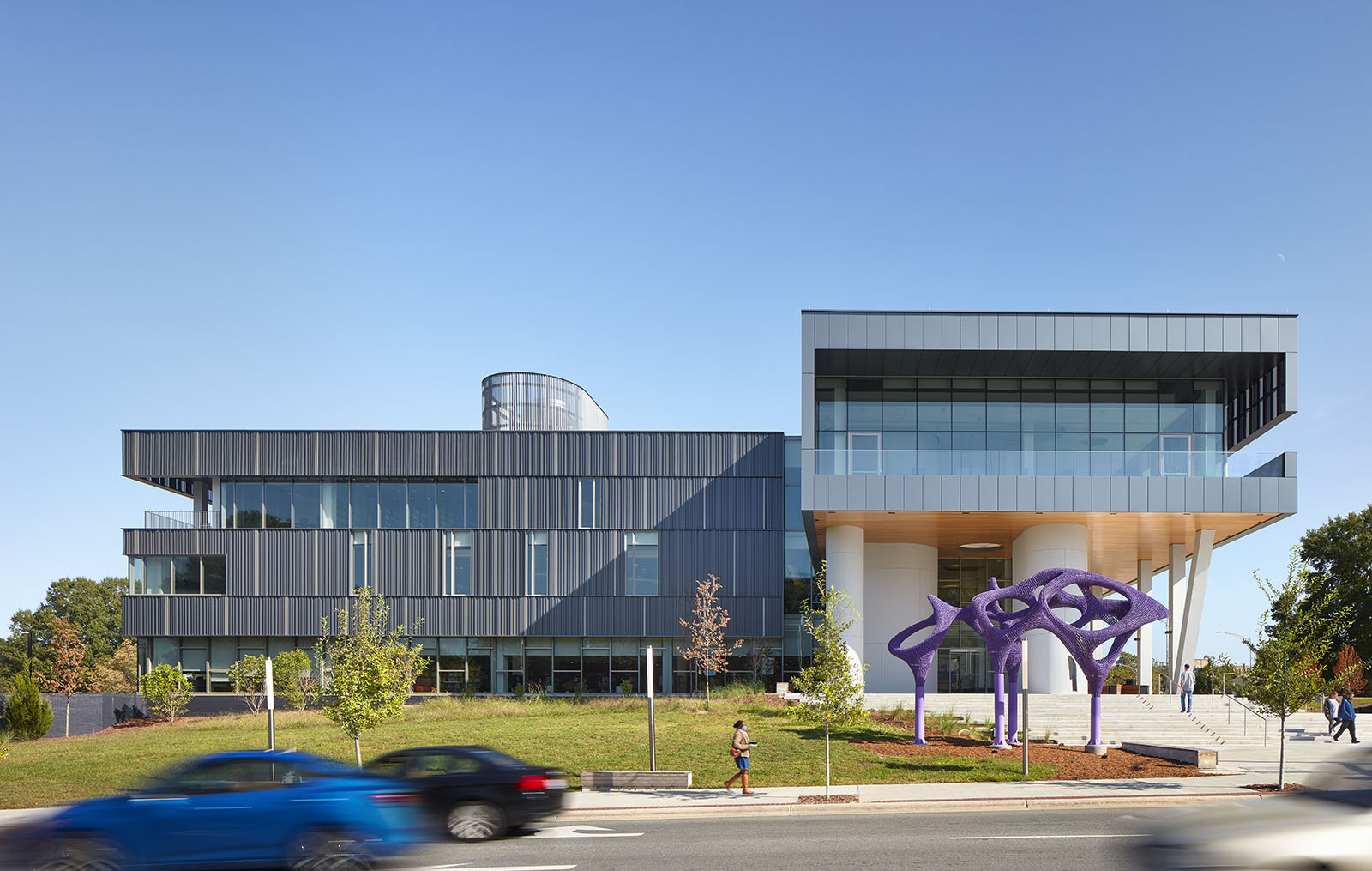 Facade of Main Library along Roxboro Street, with a large purple sculpture in front of the stairs leading up to the building