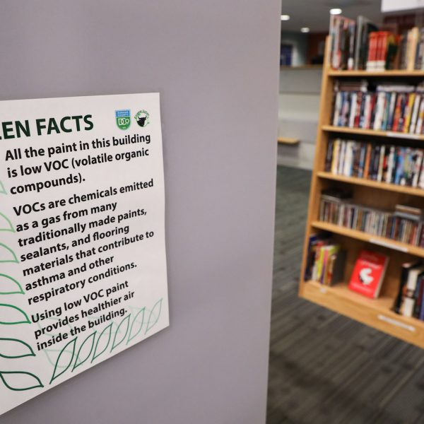 """Sign on a wall saying """"Green facts: all the paint in this building is low VOC (volatile organic compounds)."""